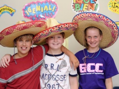 two boys and a girl in mexican hats