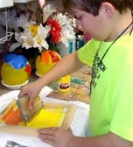 boy making stamps in art class