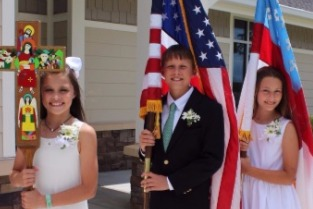 St. Nicholas Graduates carrying flags and cross