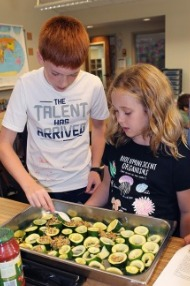 older students cooking zucchini from the garden